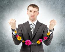 Businessman in cuffs with flowers Stock Photos