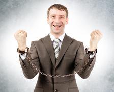 Happy businessman in cuffs - stock photo