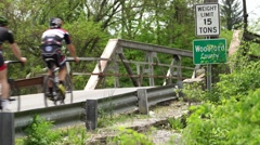 Road cyclists entering Woodford County, Kentucky Stock Footage