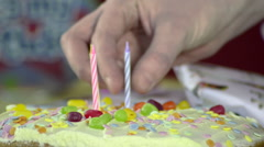 Placing Candles in a Birthday Cake - stock footage