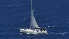 Sailboat in dark blue choppy seas Stock Footage