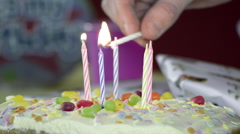 Lighting Candles on a Birthday Cake - stock footage
