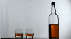 Glasses of whiskey with bottle Stock Footage