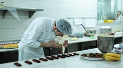 Pastry Chefs Garnish A Cake -Pastry Chef is Working Stock Footage