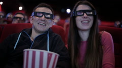 Couple in 3D glasses waching a movie at cinema - stock footage