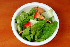 Household biowaste in white plastic bowl, green lettuce, peppers, onions Stock Photos