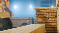Workers laid planks stacked at the sawmill Stock Footage