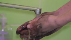 Hands dirty with mud wash water under the tap Stock Footage