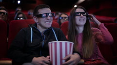 Couple waching a movie at cinema - stock footage