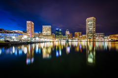 The Inner Harbor skyline at night, in Baltimore, Maryland. Stock Photos