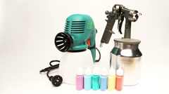 Electrical and mechanical, manual spray gun for pulverization of color - stock footage