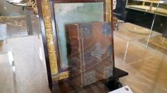 Old holy new testament bible book, Kaiser Wilhelm Memorial Church, Berlin Stock Footage