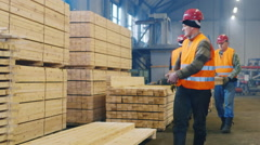 Builders are building materials, put them in a stack - stock footage