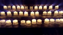Candles burn, inside Kaiser Wilhelm Memorial Church, Berlin, Germany Stock Footage