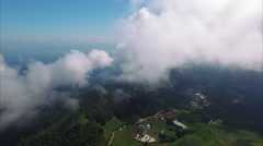 Thailand Chiang Mai Fly Through Clouds Viewing Lush Landscape - stock footage