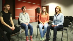 group sits in a circle. They tell their stories. psychological relief - stock footage