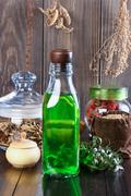 Therapeutic herbal tincture, alternative medicine, love potions, dried herbs - stock photo
