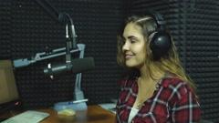 Beautiful Radio DJ in studio Stock Footage