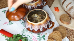 Take off the table the painted pot with vegetarian soup. Stock Footage