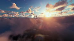 Cesna airplane above clouds at sunrise Stock Footage