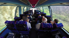 Stock Video Footage of Luxury tourist bus full of passengers traveling in Alps