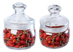 Dried wild rose in a glass jar, isolate on a white background in two ways. - stock photo