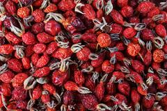 Dried rose hip, alternative medicine, close-up, a solid background. - stock photo