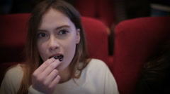 Teenage girl watching movie in cinema - stock footage