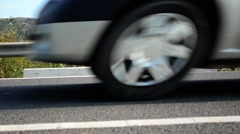 Cars passing at high speed in front of video camera - stock footage