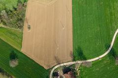 Bird's Eye View of the Agricultural parcel, arable land and greenery. - stock photo
