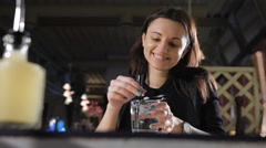 Soda for girls. The bartender mixes tubes ice in a glass Stock Footage