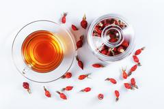 Herbal tea from rose hips, vitamin drink, hips, based on white, top view. Stock Photos
