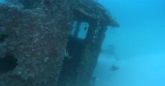 Ocean scenery wheelhouse and partially buried bow, on wreckage, 4K UltraHD, Stock Footage