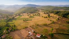 fabulous panoramic background of the village in the mountains and hills - stock photo