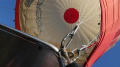 Hot air Balloon under fire during flight Stock Footage