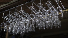 hanging wineglasses, selective focus, color reflections - stock footage