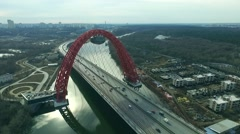 Aerial view of modern cable-stayed Zhivopisny bridge over Moskva River. Moscow, - stock footage