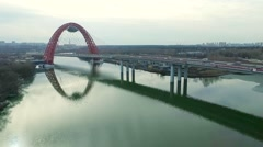Aerial view of modern cable-stayed Zhivopisny bridge over Moskva River. Moscow - stock footage