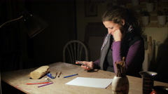 Ceramic maker writing sms in her atelier Stock Footage