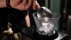 Bartender crushes ice, in the special setting Stock Footage