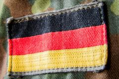 german flag appliquéd on military jacket - stock photo