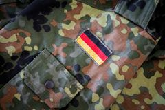 German flag on german military jacket Stock Photos