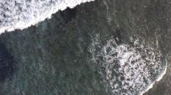 Waves breaking diagonally Stock Footage