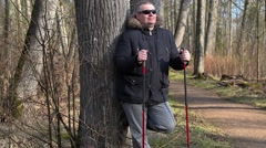 Hiker with walking sticks enjoy nature in park Stock Footage