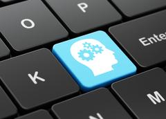Education concept: Head With Gears on computer keyboard background Stock Illustration