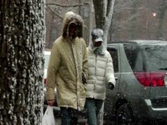 Couple walking during winter snowy day in new york Stock Footage