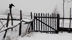 Wooden gate and fence that surrounds the property in the path that rummages Stock Footage