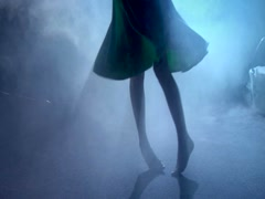 Girl dancing in atmospheric mysterious dreamlike smoke - stock footage