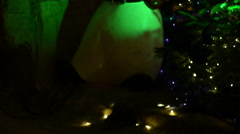 Creepy blurred green snowman statue mascot Stock Footage