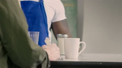 Male Waiter pouring coffee for customer, close up Stock Footage